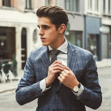 guy with hair cut and suit